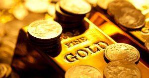 Ilustrasi investasi emas batangan dan koin emas